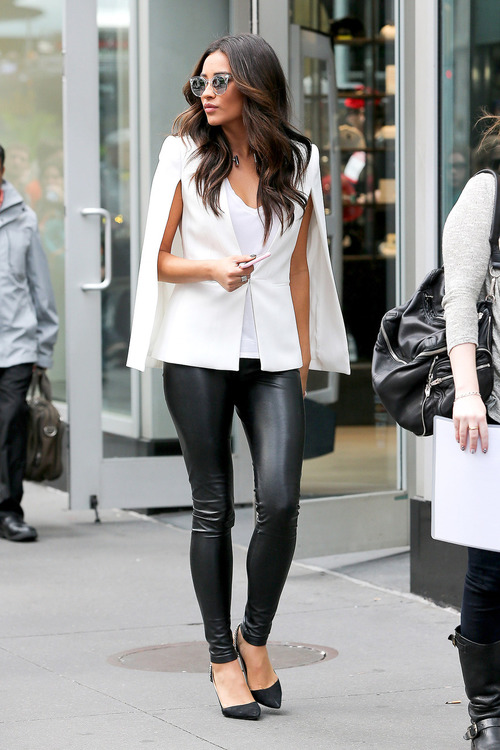 """UK CLIENTS MUST CREDIT: AKM-GSI ONLY New York, NY - """"Pretty Little Liars"""" star Shay Mitchell takes a fashionable stroll through Times Square in New York, looking tres chic dressed in a white caped top with black leather pants.  Pictured: Shay Mitchell Ref: SPL860027  071014   Picture by: AKM-GSI / Splash News"""